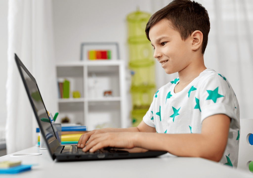 young boy coding, coding classes for kids, virtual summer camp